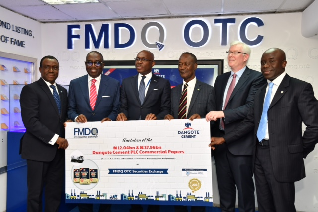 L-R:  Chief Executive Officer, Stanbic IBTC Bank PLC, Dr. Demola Sogunle; Independent Non-Executive Director Dangote Cement PLC; Mr. Ernest Ebi;  Managing Director/CEO, FMDQ OTC Securities Exchange, Mr. Bola Onadele. Koko; Group Chief Executive Officer, Dangote Cement PLC, Engr. Joseph Makoju; Group Chief Financial Officer, Dangote Cement PLC, Mr. Brian Egan; and Executive Director/Head, Debt Capital Markets, Stanbic IBTC Capital Limited, Mr. Kobby Bentsi-Enchill; at the Quotation Ceremony for the Dangote Cement PLC ₦50.00 billion Commercial Paper notes, on FMDQ OTC Securities Exchange in Lagos.