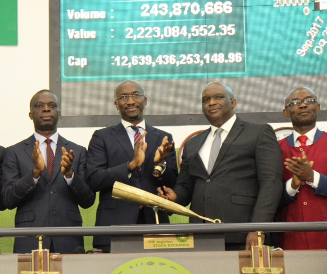 ·    L – R shows Bola Adeeko, Head, Shared Services Division, The Nigerian Stock Exchange (NSE) presenting a replica of the closing gong to Andrew Otike-Odibi, Managing Director/CEO, C&I Leasing PLC during the Facts Behind the Figures presentation at the Exchange Yesterday.