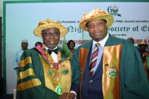 NSE President, Engr. Adekunle Mokuolu (left) congratulating Engr. Farouk Umar on his investiture as Fellow, NSE.