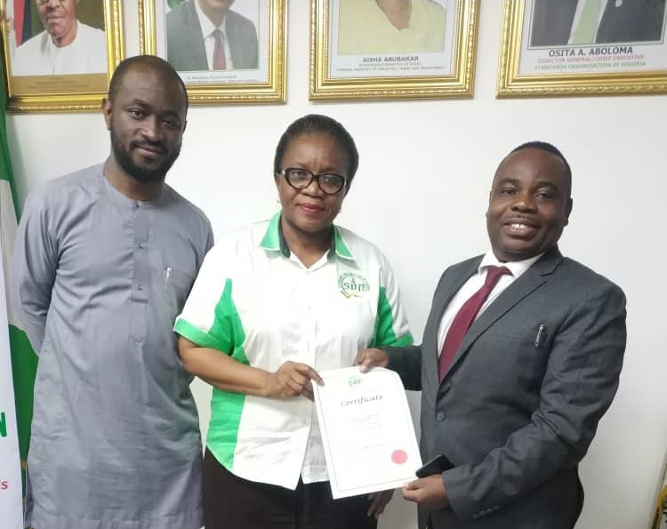 L-R: Mr. Henry Sanyaolu, Regulatory Liaison Manager, Axxela Limited with Mrs Oluremi Ayeni, Director, Management Systems Certification, Standards Organisation of Nigeria (SON) presenting the ISO 45001:2018 certificate to Mr. Uche Okpala, Environment, Health, Safety, and Quality (EHSQ) Manager, Axxela Limited in Lagos, recently.