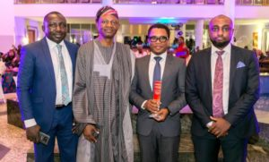R-L: Editor Businessday Newspaper, Mr. Patrick Atuanya; Head, Corporate Communications, Asset Management Corporation of Nigeria (AMCON); Mr. Jude Nwauzor; Businessday Publisher/CEO, Mr. Frank Aigbogun and General Manager Businessday (North), Mr. Bashir Ibrahim Hassan in a group photograph after Nwauzor received the award on behalf of AMCON MD/CEO in…Abuja.