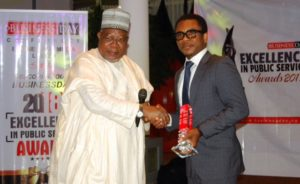 Head, Corporate Communications, Asset Management Corporation of Nigeria (AMCON); Mr. Jude Nwauzor, receiving on behalf of AMCON MD/CEO the Businessday Excellence In Public Service Award 2018 from Alhaji Umaru Abdul Mutalab, the former Chairman of First Bank at the event at the Shehu Musa Yar'Adua Centre, Abuja