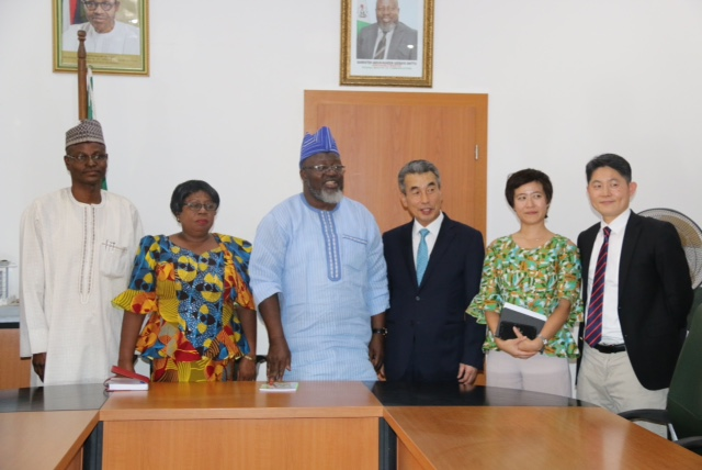 L-R: Permanent Secretary Designate, Engr. Festus Dawodu, Permanent Secretary, Mrs. Nkechi Ejele, Minister of Communications, Dr. Adebayo Shittu, South Korean Ambassador to Nigeria, Mr. In-tae Lee, outgoing KOICA Director, Sook Hyun, incoming KOICA Director, Woo Chan Chang and FMC Directors during a courtesy visit to the Ministry's Headquarters in Abuja.