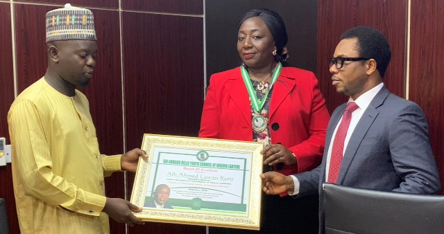 L-R: Comrade Sagir Adam, Chairman Award Committee, Sir Ahmadu Bello Youth Council of Nigeria (ABYCN), presenting the council's Honorary Medal and framed Certificate of Mr. Ahmed Lawan Kuru, Managing Director/Chief Executive Officer, Asset Management Corporation of Nigeria (AMCON), received on his behalf by Mrs. Iyatum Adode-Kobiti, AMCON Group Head, Corporate Services and Mr. Jude Nwauzor, AMCON Spokesperson in Abuja during the week