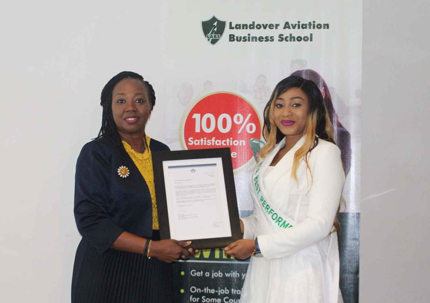 Photo Caption 1:    L-R: Mrs. Aduke Atiba, Executive Director, Landover Company Limited, presenting the 2018 IATA Best Performer in Nigeria Award to Ms. Adeola Alade, a graduate of Landover Aviation Business School (LABS), at the School in Lagos, recently