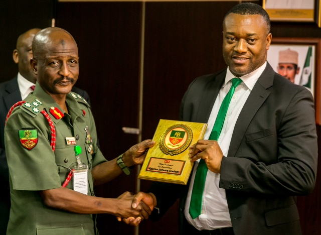 Executive Director, Asset Management Corporation of Nigeria (AMCON), Dr. Eberechukwu Uneze receiving the plaque from Brigadier-General Ibrahim Mohammed Jallo, the Academy Registrar, Nigerian Defence Academy (NDA) when the latter visited AMCON head office, Abuja with some Accounting Cadets from the academy