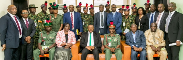 Executive Director, Asset Management Corporation of Nigeria (AMCON), Dr. Eberechukwu Uneze and Brigadier-General Ibrahim Mohammed Jallo, the Academy Registrar, Nigerian Defence Academy (sitting middle) with other officers and men from the academy; some senior officials of AMCON as well as some of the cadets in a group photograph at the end of the visit…in Abuja, recently