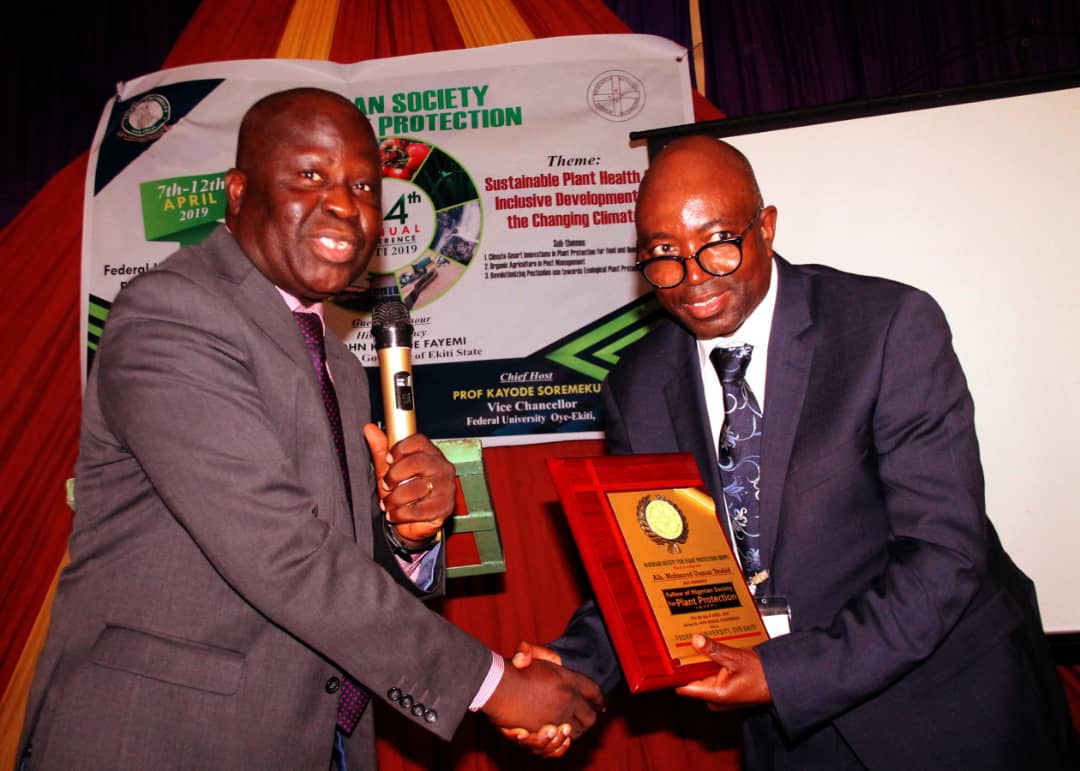 From left: Deputy Vice-Chancellor, Federal University, Oye-Ekiti, Professor Sunday Abayomi Fashina; President, Croplife Nigeria, Alhaji Mahmood Usman Tauhid at Tauhid's conferment as Fellow, Nigerian Society of Plant Protection (NSPP) during the society's 4th Annual Conference recently held in Oye-Ekiti, Southwest Nigeria.