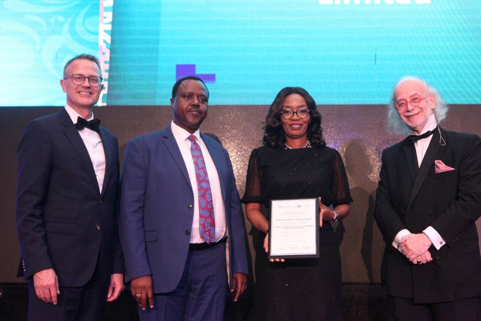 L-R: Member, International Advisory Council, Global Wealth and Society Awards Programme, Mr. Gordian Gaeta; Chief Executive, Stanbic IBTC Pension Managers Limited, Mr. Eric Fajemisin; Executive Director, Business Development, Stanbic IBTC Pension Managers Limited, Mrs. Nike Bajomo; and Member, International Advisory Council, Global Wealth and Society Awards Programme, Mr. Urs Bolt, during the presentation of the Best Asset Fund Management Company in West Africa Award to Stanbic IBTC Pension Managers Limited at The Wealth and Society West Africa Awards 2019 in Lagos recently.