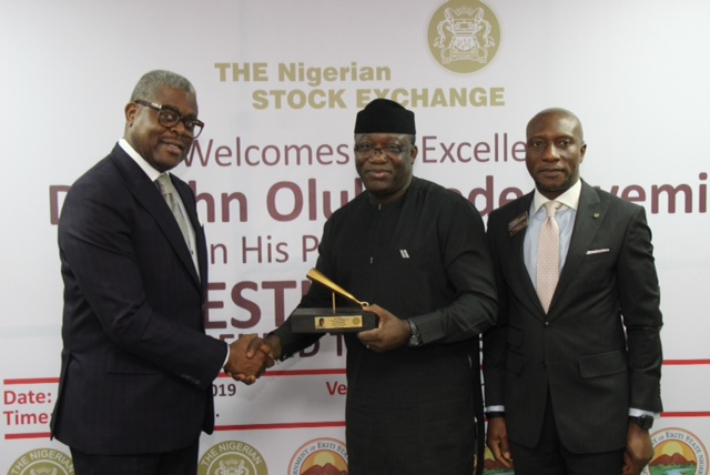 § L – R shows Otunba Abimbola Ogunbanjo, National Council President, The Nigerian Stock Exchange (NSE); His Excellency, Dr. Olukayode Fayemi, CON, Executive Governor of Ekiti State and Oscar N. Onyema, OON, Chief Executive Officer, NSE during the presentation of the replica of the NSE Closing Gong at the Facts Behind the State Economy presentation at the Exchange in Lagos.