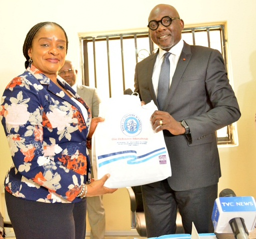 Representative of the Managing Director NPA and the General Manager, Managing Director's office Dr. Chinwe Abama receives a present on behalf of the Managing Director from the in-coming Secretary General of Port Management Association of West And Central Africa (PMAWCA) Mr. Jean-Marie Koffi during the event at Apapa, Lagos.