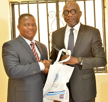 The outgoing Secretary General of Port Management Association of West AndCentral Africa (PMAWCA) Augustin Fatondji Tonan receives a gift from the in-coming Secretary General of the Association, Jean Marie Koffi at the handing over ceremony in Lagos tod