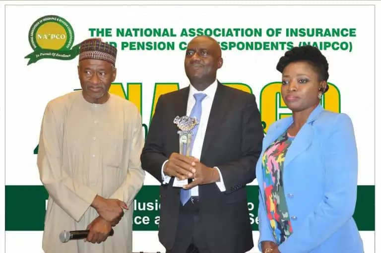 Ken Aghoghovbia, deputy managing director/COO, African Reinsurance Corporation (Africa Re) (middle) receiving award of the 2018 NAIPCO Insurance Development Promoter Award from Mohammad Ahmad, chairman of the NAIPCO 2019 National Conference, (left) and NAIPCO President, Omobola Tolu-Kusimo (right) during the conference in Lagos.