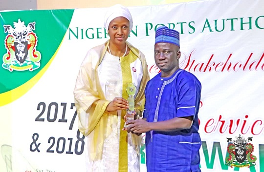 1. L-R: The MD NPA, Hadiza Bala USMAN presents an award to Sunday Oyeyipo for the Best Practice Financial Reporting Unit of the Account Division during the NPA Long Service & Merit Award in .