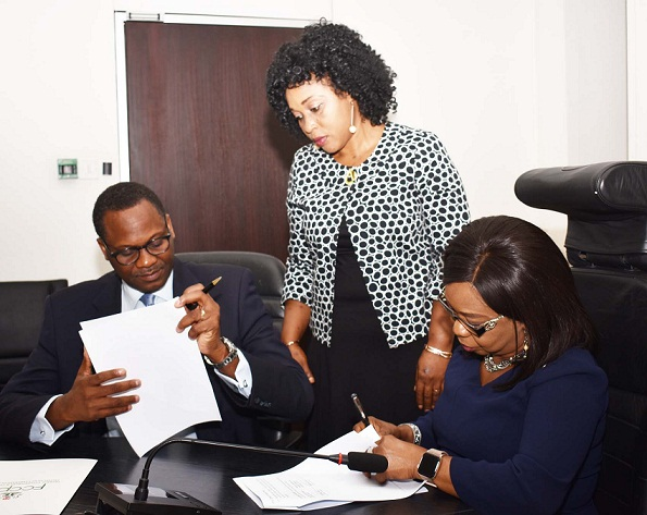Chief Executive Officer, Federal Competition and Consumer Protection Commission, Mr Babatunde Irukera, FCCPC  Deputy Director Legal  Mrs Bolanle Adeyinka, Acting, Director General, Securities and Exchange Commission Ms Mary Uduk and Head of Department,  Securities and Investments Services, SEC Mr Abbas Abdulkadir During the Signing of MOU Between SEC and FCCPC on Merger Review in Abuja