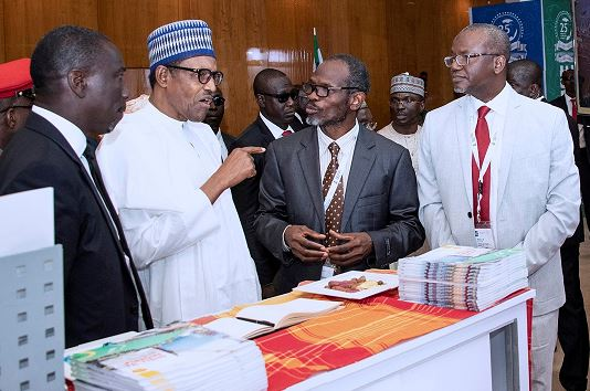 Chairman, Nigeria Economic Summit Group, Asue Ighodalo; President Muhammed Buhari; Commercial Integration Manager, Shell Nigeria, Taaj Shobayo; and Shell Nigeria's General Manager, Business and Government Relations, Bashir Bello, during the visit of the President to the exhibition booth of Shell companies in Nigeria at the opening session of the 25th Nigeria Economic Summit in Abuja… on Monday