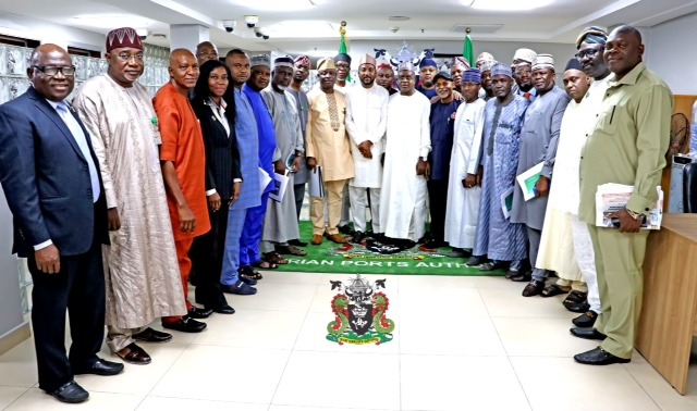 The Representative of the Managing Director, Nigerian Ports Authority (NPA), Executive Director, Finance and Administration, Mohammed Bello- Koko (standing 10th from left), Chairman, House of Rep. Committee on Ports and Harbours, Hon. Garba Datti Muhammad (standing 11th from left), top Management of NPA, House of Rep. Committee Members at the occasion.