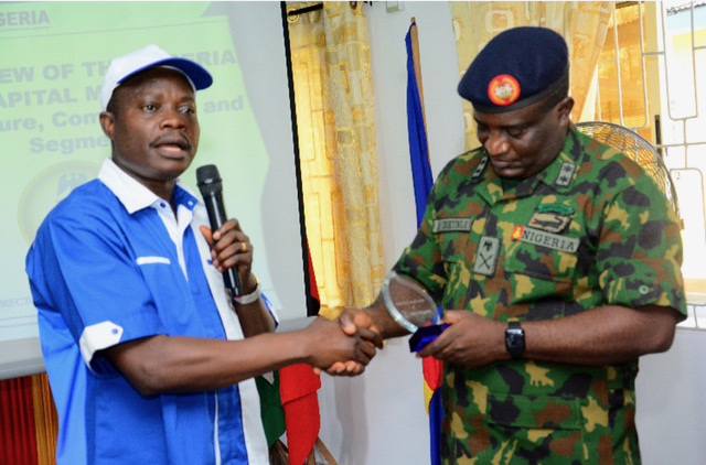 Pix 1&2, Left to Right: Head Lagos Zonal office of the Securities and Exchange Commussion, SEC, Mr. Stephen Falomo, presenting a plaque to Major General Ayobami Ibikunle, Commandant, Nigerian Army Ordinance School, Ojo, during an enlightenment campaign by the SEC at Nigerian Army Ordinance School, Ojo, Lagos.