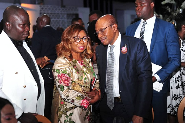 Left to Right: Registrar/Chief Executive , Chartered Institute of Bankers of Nigeria (CIBN) Mr. Oluseye David Awojobi, Acting Director General, Securities and Exchange Commission, Ms. Mary Uduk and Governor, Central Bank of Nigeria, Mr. Godwin Emefiele during the 54th Bankers Dinner held in Lagos, Weekend