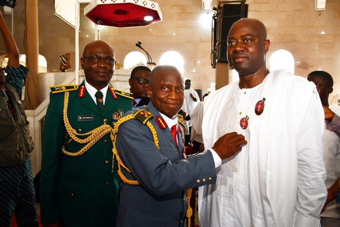 Oyo State Governor, Engr Seyi Makinde (right) being decorate with 2020 emblem by Chairman, Nigerian Legion, Oyo State chapter, Deacon Micheal Fajimi (middle) why General Officer Commanding 2 Division of Nigerian Army, Major General AB Omozoje look on during the 2020 Armed Forces Remembrance Day celebration service held at St Peter's Cathedral Aremo, Ibadan. PHOTO: Oyo State Government.