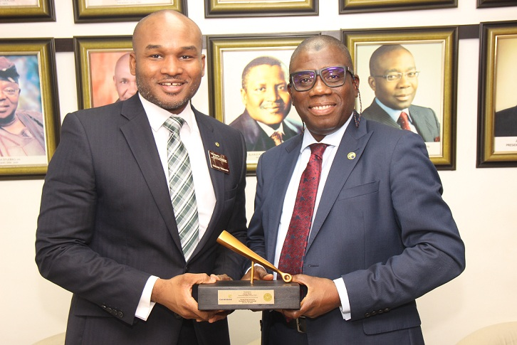 L – R shows Olumide Bolumole, Head, Listings Business Division, The Nigerian Stock Exchange (NSE) presenting a replica of the Closing Gong to Ganiyu Musa, Group Managing Director/Chief Executive Officer, Cornerstone Insurance Plc during the company's courtesy visit to The Exchange, Lagos on Wednesday, 15 January 2020.