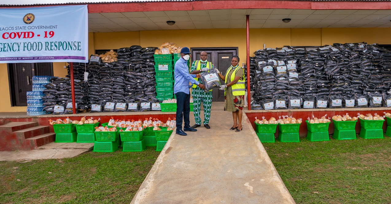 L-R: Lagos State Governor, Mr. Babajide Sanwo-Olu; holding one of the food item, supported by the Commissioner for Agriculture, Prince Gbolahan Lawal and Special Adviser to the Governor on Agriculture, Ms. Abisola Olusanya during an inspection of the COVID-19 Emergency Food Response by the Lagos Government, at the Ministry of Agriculture and Cooperatives premises in Agege, on Friday, March 27, 2020.