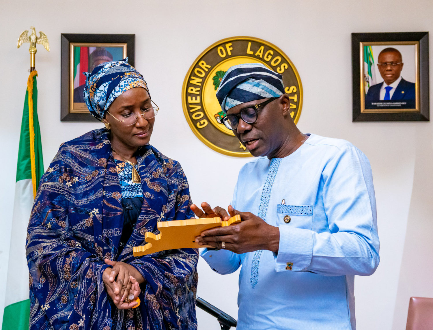 Minister of Humanitarian Affairs, Disaster Management and Social Development, Hajiya Sadiya Umar Farouq (left) being presented with a plaque by Lagos State Governor, Mr. Babajide Sanwo-Olu during a commiseration visit over the recent Abule-AdoSoba explosions at Lagos House, Marina, on Wednesday, March 18, 2020.