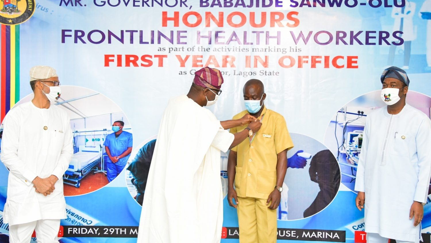 L-R: Lagos State Commissioner for Health, Prof. Akin Abayomi; Governor Babajide Sanwo-Olu, decorating a Frontline Health worker, Mr Tajudeen Bankole - Security Officer of Mainland Hospital Yaba and the Deputy Governor, Dr. Obafemi Hamzat during the Governor's award presentation to Frontline Health workers as part of activities to commemorate his administration's First Year in Office, at Lagos House, Marina, on Friday, May 29, 2020.