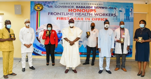 Lagos State Governor, Mr. Babajide Sanwo-Olu (middle); Deputy Governor, Dr. Obafemi Hamzat (third right); Commissioner for Health, Prof. Akin Abayomi and and some Frontline Health workers being honoured by the Governor as part of activities to commemorate his administration's First Year in Office, at Lagos House, Marina, on Friday, May 29, 2020.