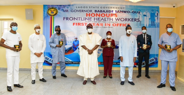 Lagos State Governor, Mr. Babajide Sanwo-Olu (middle); Deputy Governor, Dr. Obafemi Hamzat (third right); Commissioner for Health, Prof. Akin Abayomi (second left) and some Frontline Health workers being honoured by the Governor as part of activities to commemorate his administration's First Year in Office, at Lagos House, Marina, on Friday, May 29, 2020.