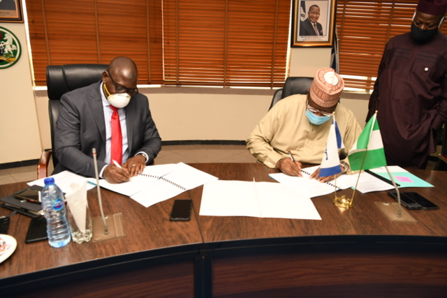 L-R: Muhammad Nami, Executive Chairman, Federal Inland Revenue Service (FIRS); Prof. Umar Danbatta, Executive Vice Chairman, Nigerian Communications Commission (NCC) signing the Memorandum of Understating (MoU) to ascertain Value-Added Tax (VAT) elements in telco's transactions in Abuja on Tuesday.
