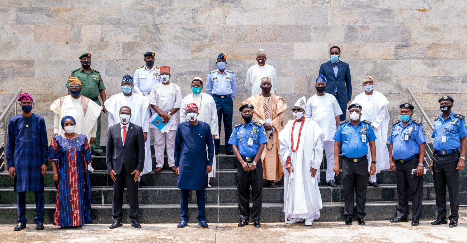 Lagos State Governor, Mr. Babajide Sanwo-Olu (fourth left); representative of IGP, Assistant Inspector General of Police (AIG), Training & Development, Force Headquarters, Mr. David Folawiyo (middle); Oba of Lagos & Co-Chairman, State Community Policing Advisory Committee (SCPAC), Oba Rilwan Akiolu I (fourth right); State Commissioner of Police & Co-Chairman of SCPAC, Mr. Hakeem Odumosu (right); Deputy Governor, Dr. Obafemi Hamzat (third left); Secretary to the Lagos State Government, Mrs. Folasade Jaji (second left); Chief of Staff to the Governor, Mr. Tayo Ayinde (left) and others, during the inauguration of SCPAC and the State Community Policing Committee (SCPC), at Lagos House, Alausa, Ikeja, on Wednesday, June 3, 2020.