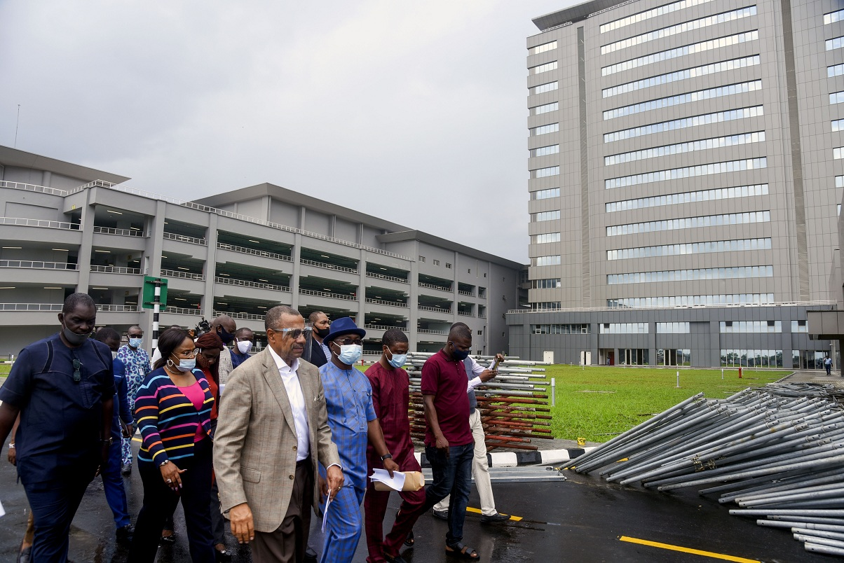 Managing Director of Megastar Technical and Construction Company, Arch. Harcourt Aduke; Director, Planning, Research and Statistics (PRS) NCDMB, Mr. Patrick Daziba Obah; General Manager, Facility and Logistics Division (FLD), NCDMB, Mrs. Maureen Ohaeri and other personnel of the Board assessing the facilities of newly completed NCDMB Headquarters Building in Yenagoa, Bayelsa State on Monday.