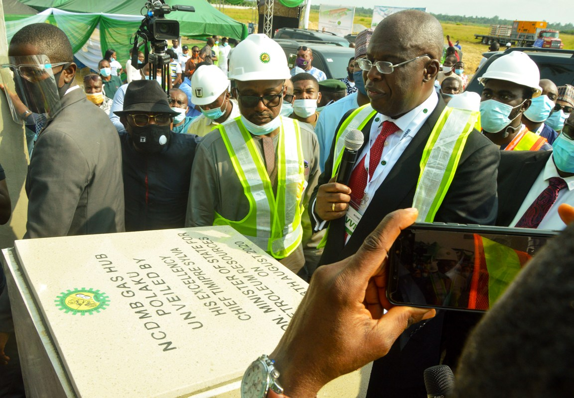 Minister of State for Petroleum Resources, Chief Timipre Sylva unveiling the NCDMB Gas Hub at Polaku community, Bayelsa state, with Executive Secretary, Nigerian Content Development and Monitoring Board, Engr. Simbi Kesiye Wabote.