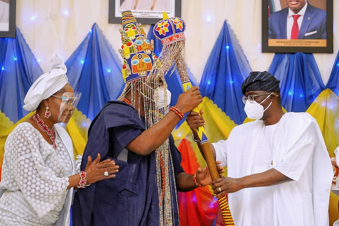 "R-L: Lagos State Governor, Mr. Babajide Sanwo-Olu (second right), presenting Staff of Office and instrument of Appointment to Alara of Ilara Kingdom, Oba Olufolarin Olukayode Ogunsanwo, Telade IV (second left), while Princess Aderonke Ogunsanwo ""Yeye-Oba"" (left), watches, during the presentation at the Alara of Ilara Palace, Eredo - Epe, Lagos, on Sunday, August 16, 2020."