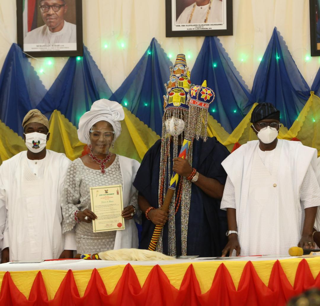 """Lagos State Governor, Mr. Babajide Sanwo-Olu (second right), presenting the instrument of Office to Alara of Ilara Kingdom, Oba Olufolarin Olukayode Ogunsanwo, Telade IV (second left), while Princess Aderonke Ogunsanwo """"Yeye-Oba"""" (left) and Commissioner for Local Government and Community Affairs, Dr. Wale Ahmed, watch on, during the presentation of Staff of Office and instrument of Appointment to Alara of Ilara at his Palace, Eredo - Epe, Lagos, on Sunday, August 16, 2020."""