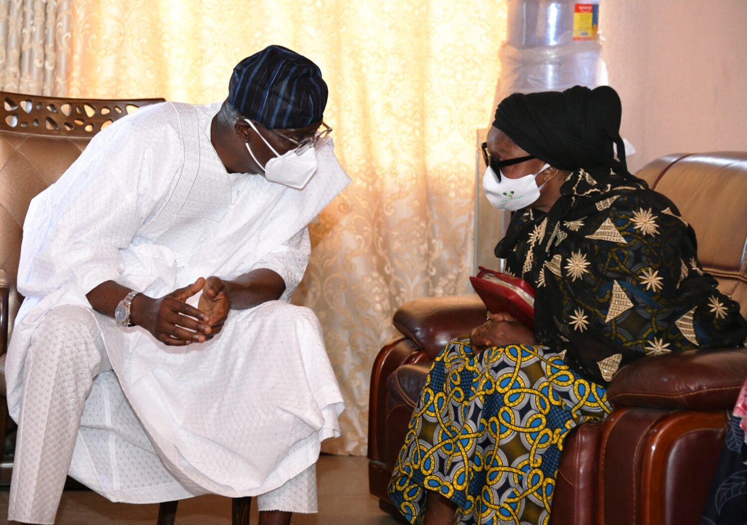Lagos State Governor, Mr Babajide Sanwo-Olu (left), condoling with wife of the deceased, Mrs. Jumoke Rasak during a condolence visit to the family of late Chief Lanre Razak, on Sunday, August 16, 2020.