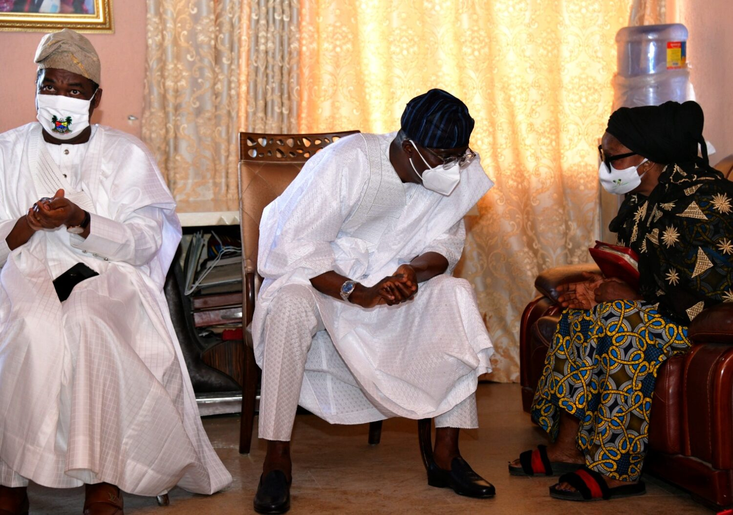 L-R: Lagos State Deputy Governor, Dr. Obafemi Hamzat; Governor Babajide Sanwo-Olu and wife of the deceased, Mrs. Jumoke Rasak, during a condolence visit to the family of late Chief Lanre Razak, on Sunday, August 16, 2020.