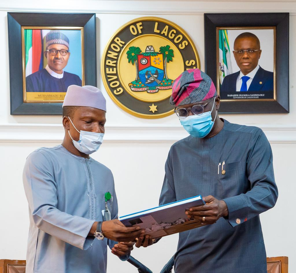 L-R: Managing Director/CE, Federal Airports Authority of Nigeria (FAAN), Capt. Rabiu Hamisu Yadudu, receiving a compendium from Lagos State Governor, Mr. Babajide Sanwo-Olu.