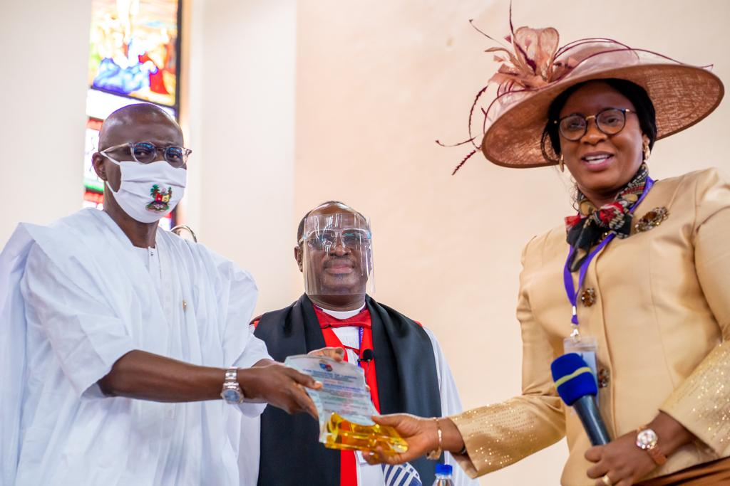 L-R: Lagos State Governor, Mr. Babajide Sanwo-Olu, being presented with a plaque, Bishop and Missioner of Lagos Diocese, Rt. Revd. Humphrey Olumakaiye and his wife Prof. (Mrs) Motunrayo during the opening of the 2nd session of the 34th Synod of the Lagos Diocese at Our Saviour's Church, TBS, on Monday, September 7, 2020.