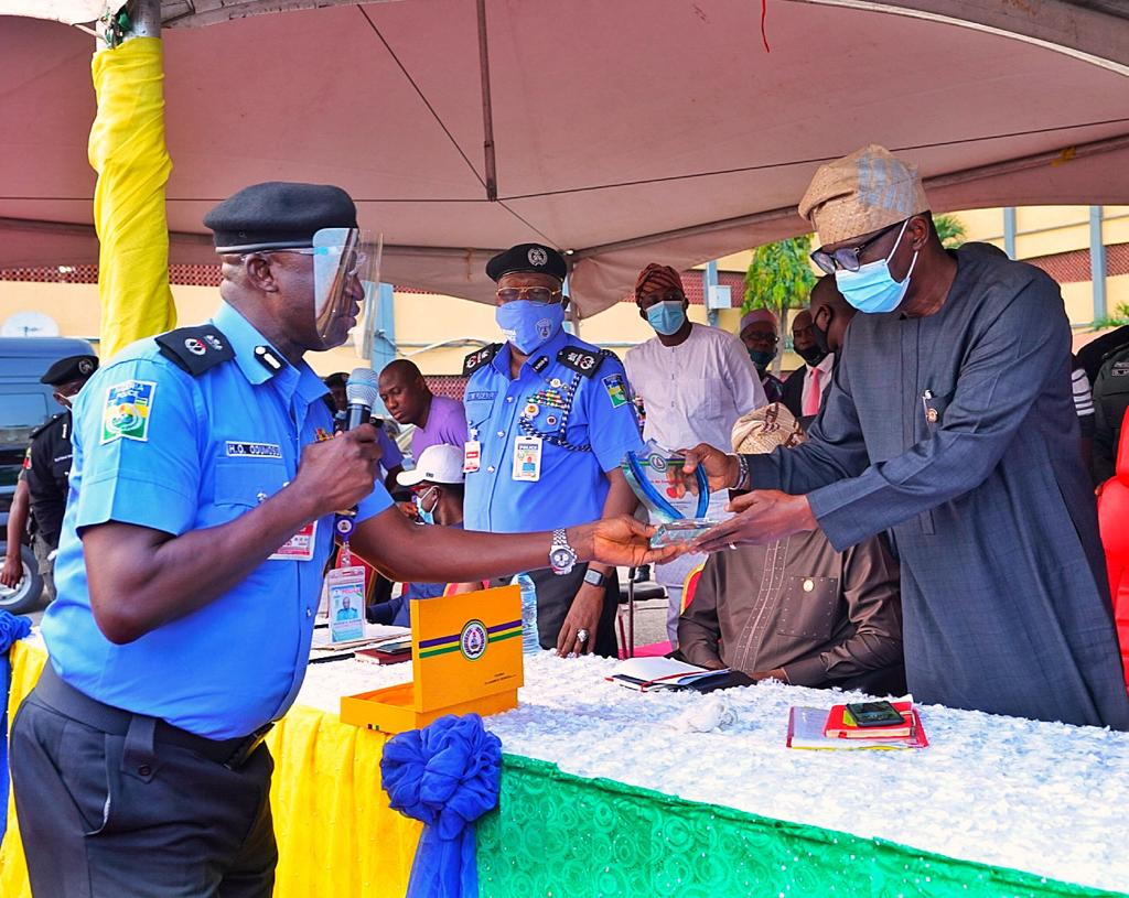 Lagos State Commissioner of Police, Mr. Hakeem Odumosu (left) presenting a plaque to the Lagos State Governor, Mr. Babajide Sanwo-Olu, during the Governor's visit to the Police Command Headquarters, Ikeja, on Wednesday, October, 28, 2020.