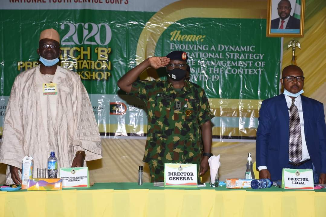 L-R; The Director, Skill Acquisition and Entrepreneurship Development, Mr Hilary Nasamu, NYSC Director-General, Brigadier General Shuaibu Ibrahim and the Director, Legal Services, Barrister Tijjani Ibrahim at the first business session during the 2020 Batch 'B' Orientation Workshop holding in Jos, Plateau State.
