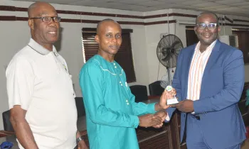 From left: Former President, National Association of Insurance and Pension Correspondents, Kelvil Egerue; Chairman, Chuks Udo Okonta, presenting NAIPCO Corporate Communications Managers of the year 2020 award (operator) to Head, Strategic Marketing & Communications, AIICO Insurance Plc, Segun Olalandu at the event.