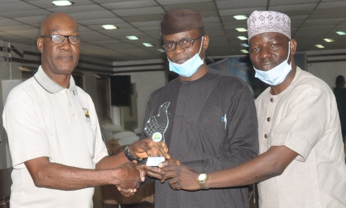 From left: Former President, National Association of Insurance and Pension Correspondents, Kelvil Egerue, presenting NAIPCO Corporate Communications Managers of the year 2020 award (regulator) to Senior Manager, South West Zonal Office, National Pension Commission, Lanre Ogedegbe, who represented the winner, Head, Corporate Communications, PenCom, Peter Aghahowa and Senior Manager, South West Zonal Office, Ladi Ishola at the event at the weekend in Lagos.