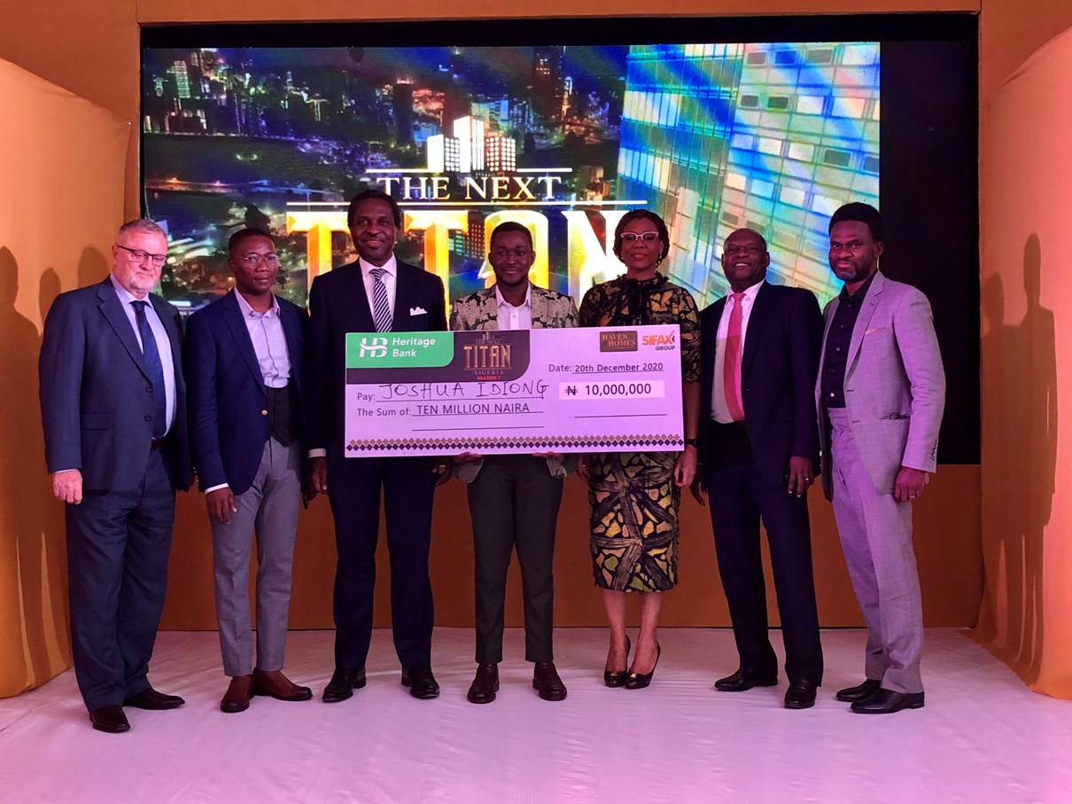 R-L: Fela Ibidapo, Divisional Head, Corporate Communications, Heritage Bank; Kyari Bukar, Lead Judge of The Next Titan; Lilian Olubi, Judge; Joshua Idiong, Winner, The Next Titan Season-7; Tonye Chris Parkes; Mide Kunle Akinlaja, Executive Producer, The Next Titan and Cole, Judge, Judge, Titan, during the presentation of N10million prize at the grand finale of The Next Titan Entrepreneurial Reality TV show Season-7, headline sponsored by Heritage Bank Plc, held in Lagos recently.