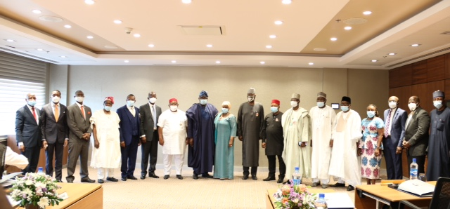 Secretary to the Government of the Federation (SGF), Mr. Boss Mustapha; Chairman, Board of National Pension Commission, Mr. Oluremi Oni; Director-General of National Pension Commission (PenCom), Mrs. Aisha Dahir-Umar (middle), flanked by members of the Board of the National Pension Commission, at their inauguration, at Transcorp Hilton, Abuja, on 3rd December 2020.