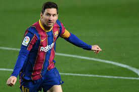 Messi extends Barcelona contract by five years, accepts wage cut
