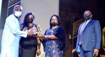 STI PhotoNews: Recieving Award As Insurance Company of the Decade.